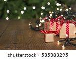 christmas gifts on wood  light...   Shutterstock . vector #535383295