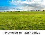 green meadow and blue sky over... | Shutterstock . vector #535425529