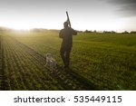 Hunter With Hunting Dog And...