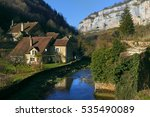 Small photo of Small river runs through the centre of the Baume-les-Messieurs village. Jura department of Franche-Comte. Baume-les-Messieurs is classified as one of the most beautiful villages of France