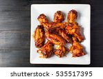baked chicken wings served on a ... | Shutterstock . vector #535517395