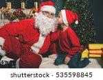 santa and boy near the... | Shutterstock . vector #535598845