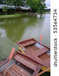 Rowboats At Dock On Side Of...