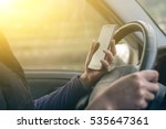 women driver with a cell phone... | Shutterstock . vector #535647361