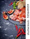 prosciutto with figs and chili...   Shutterstock . vector #535649059