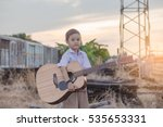 child proposing play the guitar ... | Shutterstock . vector #535653331