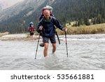 hiker crossing river at tien... | Shutterstock . vector #535661881