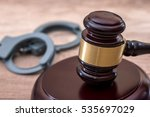 Gavel And Handcuffs On Desk