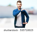 young man holding something | Shutterstock . vector #535710025