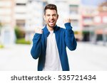 young man celebrating | Shutterstock . vector #535721434