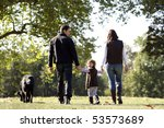Stock photo a family having a walk with a dog 53573689