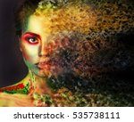 beautiful girl with creative make-up. effect photoshop. green. Creative make-up, studio photo, photo processing,