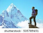 hiker with backpacks reaches... | Shutterstock . vector #535789651