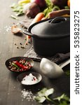 cast iron pot and vegetables on ... | Shutterstock . vector #535823275