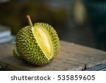 Small photo of Ripe durian on table under tree shadow in the garden background.Durian is the fruit of several tree species belonging to the genus Durio. Durian taste is combination of sweet and creamy all at once.
