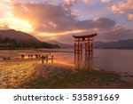 Stock photo the great torii symbol of miyajima island in sunset tiwilight and waters dropping time 535891669
