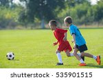 boys kicking football on the...   Shutterstock . vector #535901515