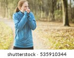 female runner warming up her... | Shutterstock . vector #535910344