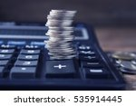 stack of coins and calculator... | Shutterstock . vector #535914445