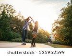 teenage couple driving a long... | Shutterstock . vector #535952599
