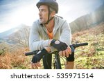 mature man riding bike in the... | Shutterstock . vector #535971514