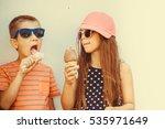 kids eating gelato and soft... | Shutterstock . vector #535971649