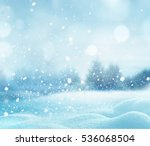 Stock photo christmas winter landscape with snow and blurred bokeh merry christmas and happy new year greeting 536068504