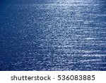 smoothly blue sea with sunlight | Shutterstock . vector #536083885