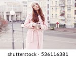 woman wearing a pink coat with... | Shutterstock . vector #536116381