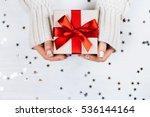 Female Hands Holding Present...