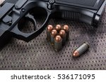 Small photo of Gun and ammo