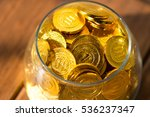 a lot of gold coins in a glass... | Shutterstock . vector #536237347