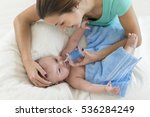 mother cleaning nose mucus of... | Shutterstock . vector #536284249