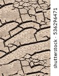 Small photo of Texture, background, seamless pattern. This is useful for designers. a crack in the ground, drought, sun. absence of water. Slit narrow groove on the surface.