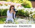 female photographer taking... | Shutterstock . vector #536300155