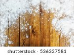 wooden desk covered by snow | Shutterstock . vector #536327581