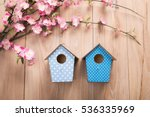 Two Birdhouses Hang On Spring...