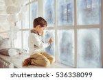Little Boy Draws On A Frozen...