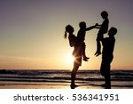 silhouette of happy family who... | Shutterstock . vector #536341951