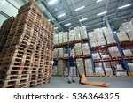 Worker With Order At Stack Of...