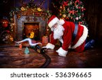 Happy Santa Claus Playing With...