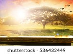Small photo of Wooden table over blured Blurred the cross on a sunset and wooden paving. Thanksgiving, Christmas, Worship, Forgiveness, Mercy, Repentance, Adoration, Glorify, Humble, Love concept