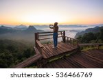 woman is standing on top of... | Shutterstock . vector #536466769