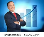 businessman on chart background. | Shutterstock . vector #536472244