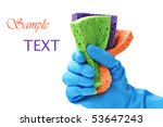 Gloved hand with colorful sponges on white background with copy space. - stock photo