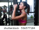 the sports young woman drinks... | Shutterstock . vector #536577184