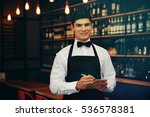 handsome male waiter in cafe | Shutterstock . vector #536578381