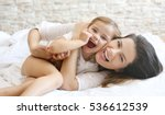 mother and daughter laying in... | Shutterstock . vector #536612539