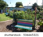 Colorful Bench In Community...