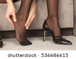 woman massaging her tired feet | Shutterstock . vector #536686615